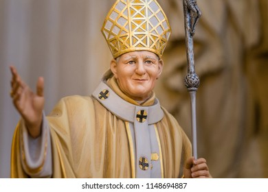 RAVENNA, ITALY - AUGUST 2, 2018: statue of Saint John Paul II with Crucifix blessing inside Church of Saint Mary of Suffrage in Ravenna