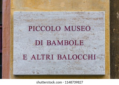 RAVENNA, ITALY - August 2, 2018: Dirt and dust cover the signboard of dolls and toys museum