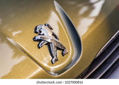 RAVENNA, ITALY - FEBRUARY 14, 2018: Moisture and dirt cover the Peugeot logo. PSA owner of the Peugeot brand is the second automaker in Europe
