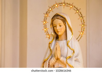 RAVENNA, ITALY - FEBRUARY 15, 2018: Statue of the Blessed Virgin Mary praying in  Church of Saint Mary of Suffrage in Ravenna