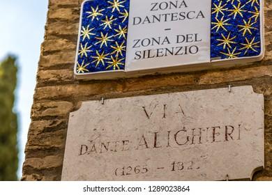 RAVENNA, ITALY - JANUARY 15, 2019: light is enlightening  street name sign of Via Dante Alighieri