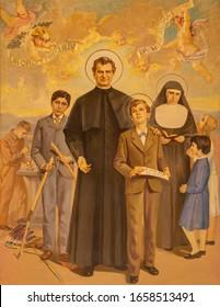 RAVENNA, ITALY - JANUARY 28, 2020: The painting St. Don Bosco in church Basilica di Santa Maria del Porto by Vittorio Cusatelli (1959).