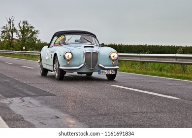 Ravenna, Italy - May 17, 2013: crew on a vintage sports car LANCIA Aurelia B24 spider (1955) in rally Mille Miglia 2013, the italian historical race (1927-1957)