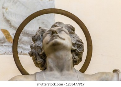 RAVENNA, ITALY - SEPTEMBER 12, 2018: light is enlightening statue of Saint Vitale in church of Saint Mary of Suffrage