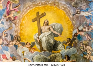RAVENNA, ITALY - SEPTEMBER 13, 2018: light is enlightening painting of Jesus Christ holding Cross in Cathedral