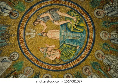 Ravenna,Italy-5.26.2011 : Arian Baptistry copula ceiling mosaic showing procession of twelve Apostles and baptism of Christ, whose naked,young body immersed in water to his hips, in gold background