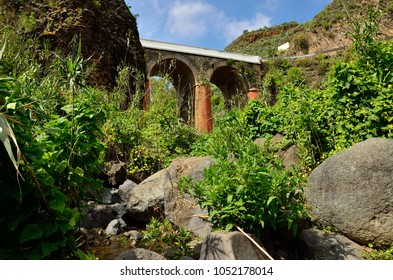 Ravine, bridge, rocks and vegetation,  Valsequillo, Gran canaria, Canary islands