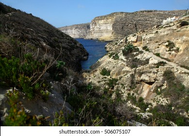 A ravine leads to the sea at Xlendi on Gozo