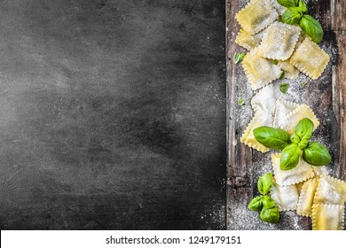 Ravioli with Basil and ricotta on dark background