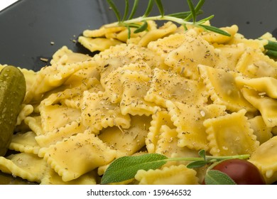 Ravioli with herbs isolated on white