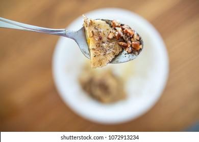 Ravioli and Pecans on Spoon
