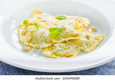 Ravioli plate with parmesan cheese close up.