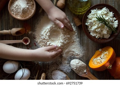 Ravioli from a pumpkin on a pumpkin dough, are prepared with the help of small hands of the son. Very tasty snack with cottage cheese, Italian cuisine Work with dough and flour with hands in the frame