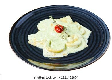 Ravioli with salmon in creamy sauce with Pesto isolated on white
