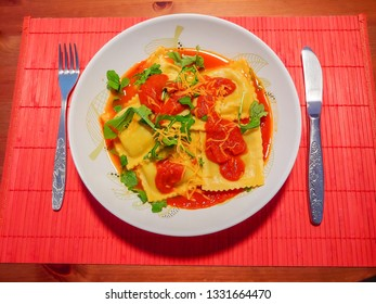 Ravioli tossed with your favorite pasta sauce, then sprinkled with freshly shaved Parmesan cheese.