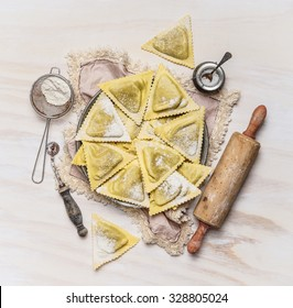 ravioli  Triangoli making set, preparation on white wooden background, top view. Italian food concept.