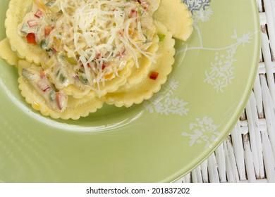 ravioli and vegetable garnish  on wooden background