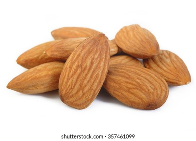 raw almond nuts isolated on white background