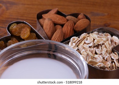 Raw almond and whole grain cereals , raisins and coconut milk.Healthy breakfast. High dietary fiber foods