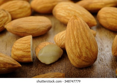 raw almonds on wooden background
