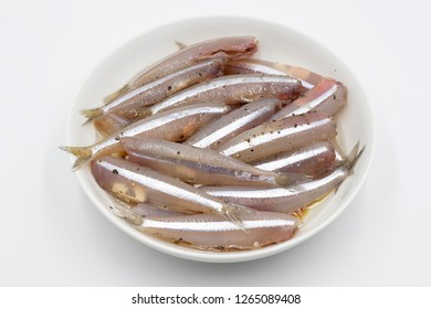Raw Anchovy on white background