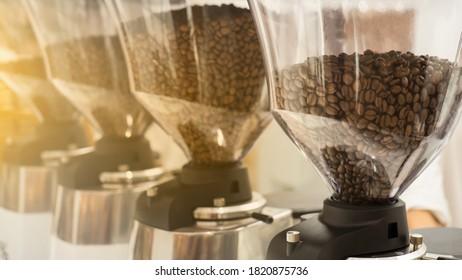 Raw arabica bean product show in coffee machine at coffee shop.