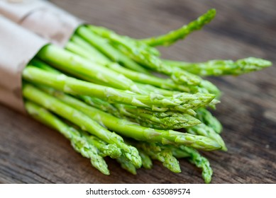 Raw asparagus. Fresh Asparagus on wooden background