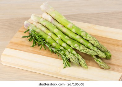 Raw asparagus heap on the wood background