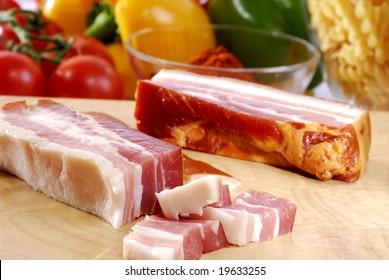 raw bacon on a board