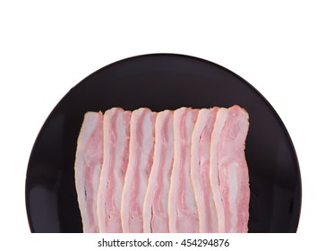 Raw bacon on dish isolated on white background