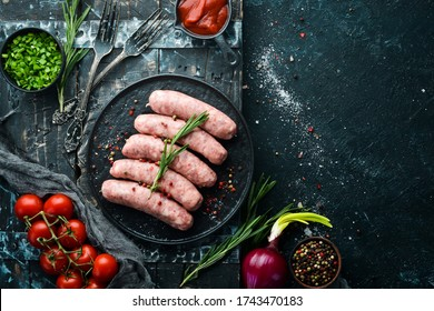 Raw barbecue sausages with spices and vegetables. Top view. Free space for your text. - Shutterstock ID 1743470183