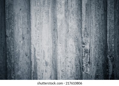 Raw or bare concrete wall, with panel lines perpendicular to image dimension