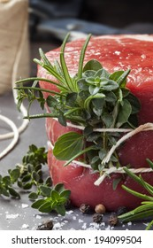 Raw beef fillet steak with herbs and spices.