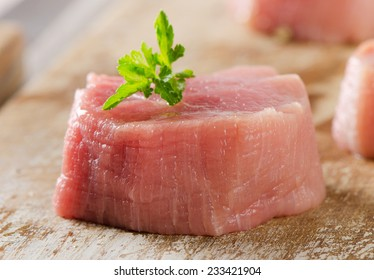 Raw beef with herbs on  wooden background. Selective focus