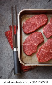 Raw beef marbled steak in a pan