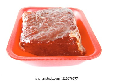 raw beef meat on red tray over white