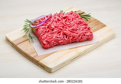 Raw beef minced meat with rosemary and onion