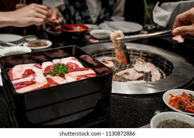 Raw beef on Plate, Beef slice on stove for barbecue at Japanese restaurant, Meat over charcoal for Japanese style, Japanese food, BBQ, Beef on grille, Japanese barbecue dinner time, Food meeting time