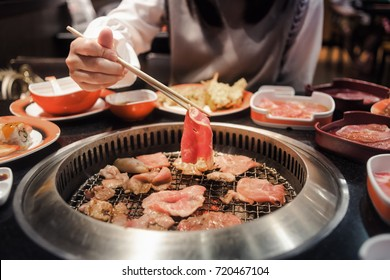 Raw beef and pork slice on grille for barbecue or Japanese style yakiniku