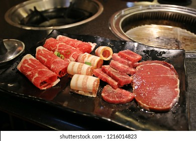 Raw beef slice for barbecue or Japanese style ,buffet grilled on hot coal at buffet restaurant.Premium Japanese wagyu   grilled over charcoal on stove.Japanese or Korean food style.