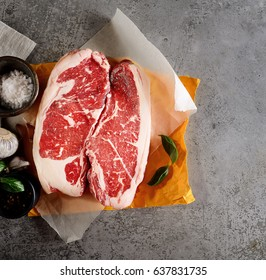 raw beef steak on paper