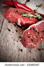 Raw beef steaks prepared for grill