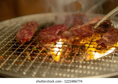 Raw beef thick slice steak on grill. Cooking beef steak in Japanese Teppanyaki style.