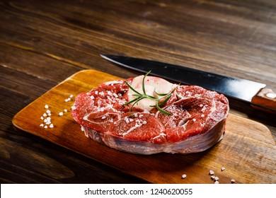 Raw beefseak on cutting board