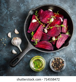 Raw beetroot with balsamic, garlic and herbs. top view, space for text.