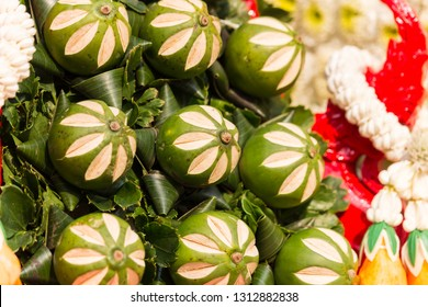 raw betel nut were carve to flower shape in flower festival parade in chiang mai , thailand