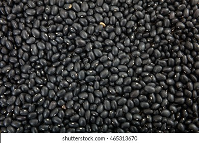 Raw black soy beans background, closeup, top view with details