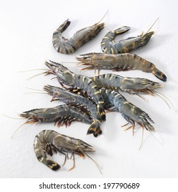 Raw black tiger prawns on a white background