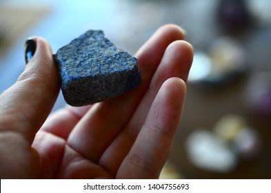 Raw Blue-Indigo Lapis Lazuli Healing Crystal. Freestanding for alters or grids! Metaphysical Lapis Lazuli natural chunk. Rough Lapis! Woman's hand holding raw chunk of lapis lazuli