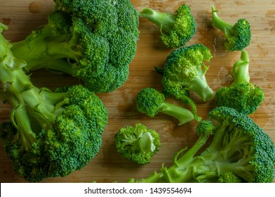 Raw brocoli on a wooden cutting board top view, macro photography